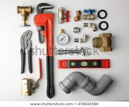 Stock fotó: Vízvezetékszerelő · szerszámok · férfi · munka · telefon · kulcsok