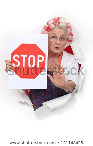 An old lady with a stop sign. Stock photo © photography33