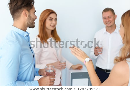 Office worker drinking glass of water Stock photo © photography33