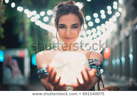 Portrait of beautiful girl with bokeh at background. stock photo © Massonforstock