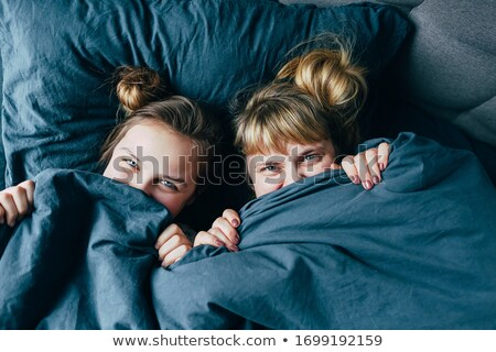 Woman and child hiding under a duvet Stock photo © photography33
