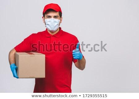 Deliveryman on white background Stock photo © photography33