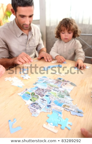 family sat by table playing game stock photo © photography33