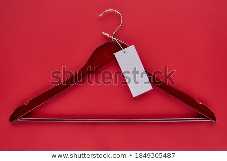 black hangers with red paper label stock photo © justinb