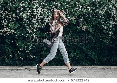 Smiling hipster girl with bag. Stock photo © Massonforstock