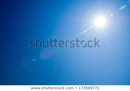 blue sky with sun rays stock photo © elenaphoto