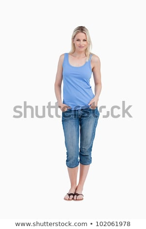 Cheerful blonde woman standing upright against a white background Stock photo © wavebreak_media