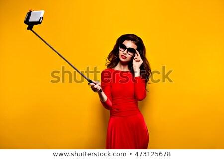 оптимистичный · женщину · Солнцезащитные · очки · изолированный · белый - Сток-фото © wavebreak_media