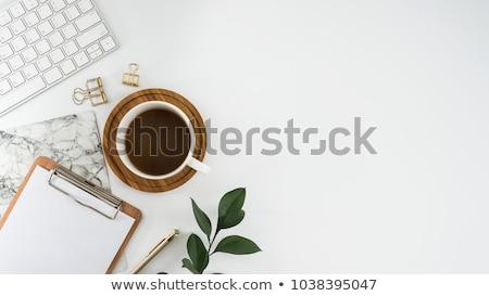 Mesa de escritório bloco de notas telefone móvel copo café branco Foto stock © rafalstachura