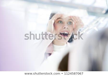 shopping woman looking at clothing window display stock photo © maridav