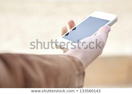 Detail view of woman using smart phone stock photo © wavebreak_media