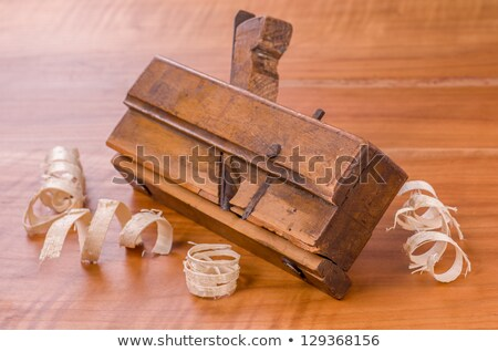 Old Molding Plane With Shavings On A Cherry Wood Board Photo stock © Zerbor