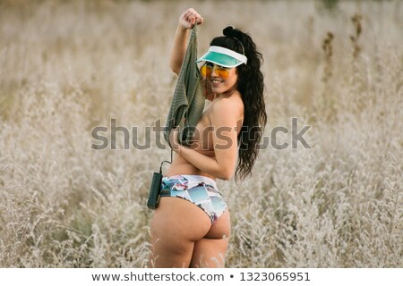 Voluptuous look of brunette young woman. old style Stock photo © Fernando_Cortes