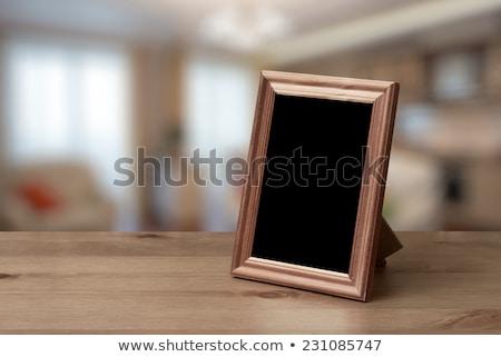 photo frame on wood table stock photo © karandaev