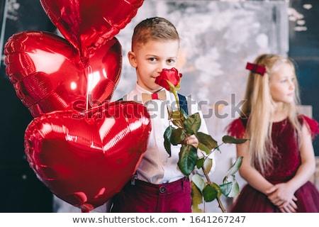 ブロンド 少女 与える 赤 キス 笑顔 ストックフォト © sebastiangauert