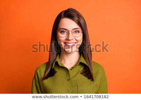 young brunette businesswoman with glasses smiling bright stock photo © sebastiangauert