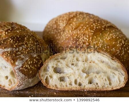 házi · készítésű · kenyér · szezámmag · cipó · friss · elszigeteltség - stock fotó © Belyaevskiy