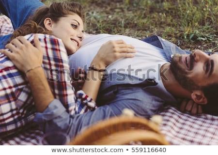 portrait · souriant · couple · séance · couverture · de · pique-nique · potable - photo stock © monkey_business