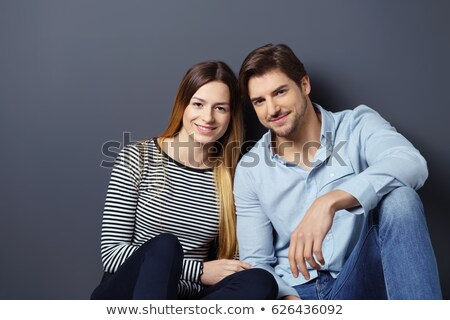 elegant couple leaning on a dark grey wall Stock photo © feedough
