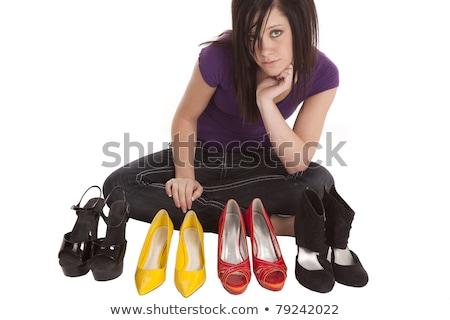 Woman having a hard time choosing what shoes to wear. Stock photo © gemenacom