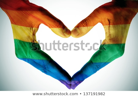 rainbow gay and lesbian symbols in heart with hands stock photo © redkoala