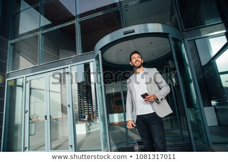 Back view portrait of a businessman sitting with laptop at office Stock photo © deandrobot