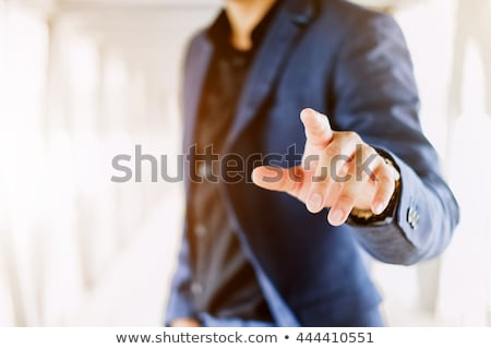 Businessman clicking on touch screen Stock photo © ymgerman