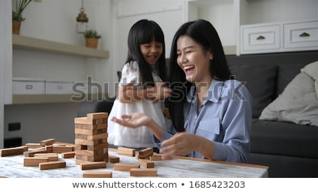 Portrait of a charming young playful woman relaxing at home - Indoor  Stock photo © deandrobot