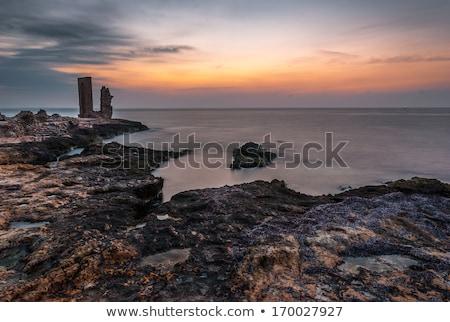 Zonsondergang zee kust oude ruines strand Stockfoto © Kayco