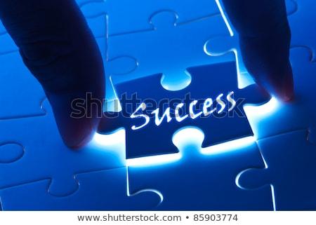 answer   white word on blue puzzles stock photo © tashatuvango