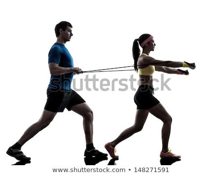 Pilates kadın ayakta lastik bant egzersiz antreman Stok fotoğraf © lunamarina