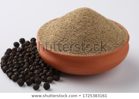 Organic Black pepper in ceramic bowl. Stock photo © ziprashantzi