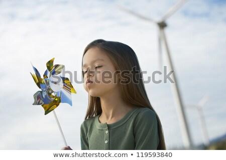Lány fúj szélmalom gyönyörű lány műanyag mosoly Stock fotó © iko
