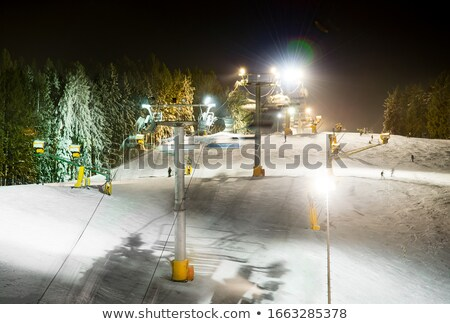 Ski slope with snow cannon at evening Stock photo © BSANI