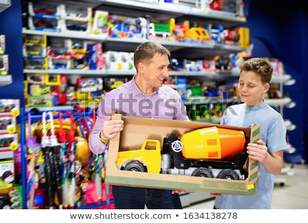 Family buying toys in toy store  stock photo © Kzenon