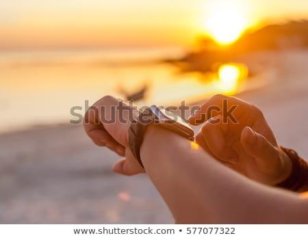 Smartwatch beach woman relaxing with wrist watch Stock photo © Maridav