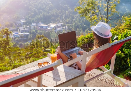 Amazed woman using laptop computer on the bed Stock photo © deandrobot