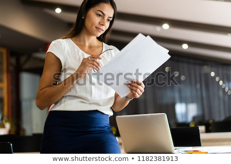 woman looks on to document Stock photo © ssuaphoto