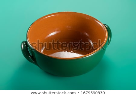 Glazed terracotta saucepan Stock photo © Digifoodstock