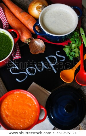 Spinach cream soup with chili in a white bowl Stock photo © frimufilms