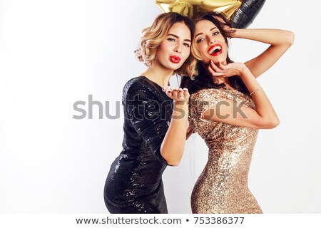 Attractive young woman in golden dress standing and posing Stock photo © deandrobot