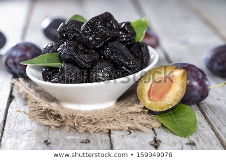 Stock photo: fresh and dried plums