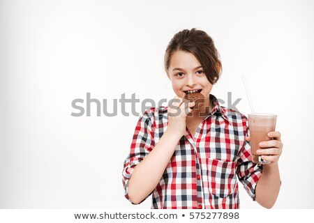 Cheerful young girl posing with cookie and cocoa Stock photo © deandrobot