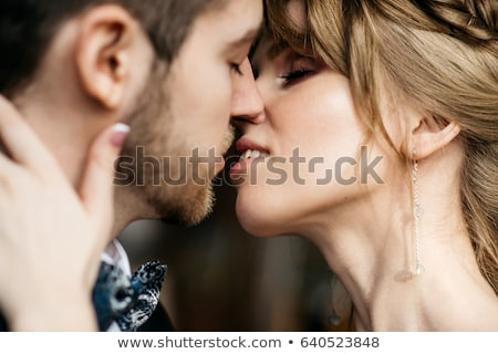 Man and woman kissing at the wedding Stock photo © mizar_21984