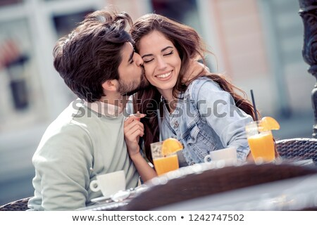 Woman with closed eyes sitting and drinking juice in cafe Stock photo © deandrobot