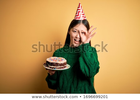 Woman at party holding birthday cake smiling Stock photo © monkey_business