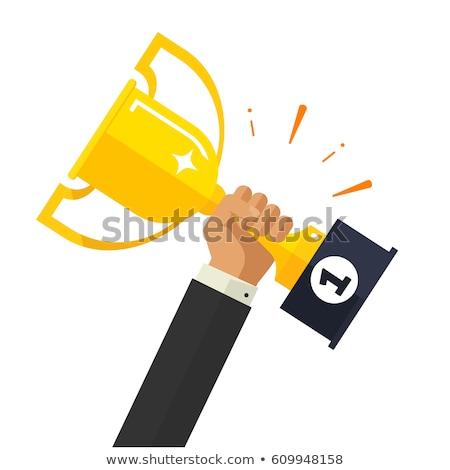 Vector cartoon style illustration of hand holding golden winner  Stock photo © curiosity