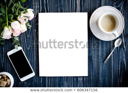 Dark styled background with coffee, smartphote and roses Stock photo © manera