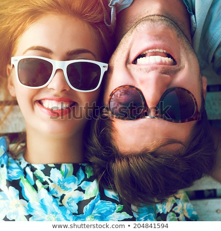 Stock photo: Portrait of friends wearing sunglasses at beach