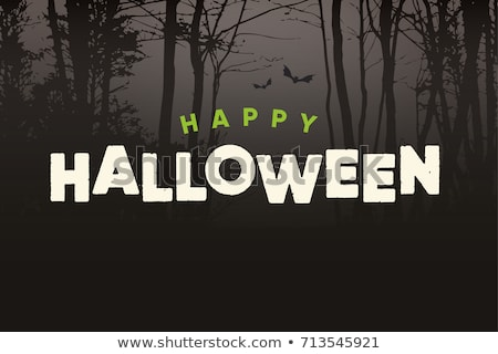happy halloween text logo with night forest background stock photo © thecorner